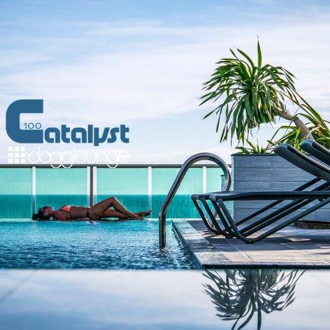 image of woman lying on deck beside rooftop pool overlooking the ocean
